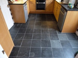 Lay uncalibrated natural slate tiles