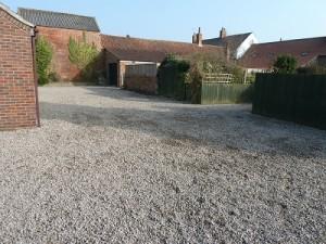 20 tonnes of gravel on communal parking area