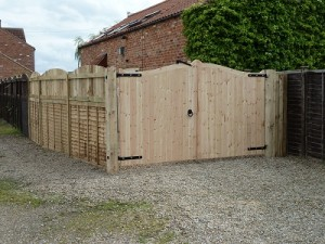 New posts, fencing and gates hung including gate furniture